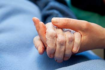 Why do nursing homes describe pressure sores according to 'stages'?