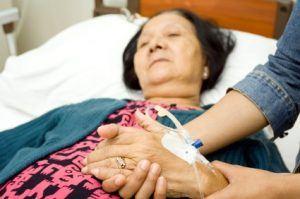 daughter caring sick elderly mother