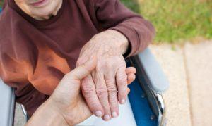elderly-woman-in-wheelchair-300x179